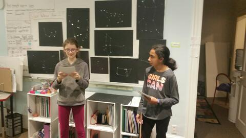 Ellis (left) and Raveena (right) present  to parents at last year's science-themed Curriculum Night
